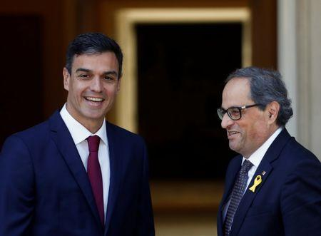 Spain's Prime Minister Pedro Sanchez smiles with with pro-independence Catalan leader Quim Torra at the Moncloa Palace in Madrid