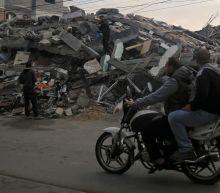 The Latest: Israeli defense minister resigns over Gaza truce