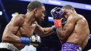 Spence stops Peterson in dazzling title defense