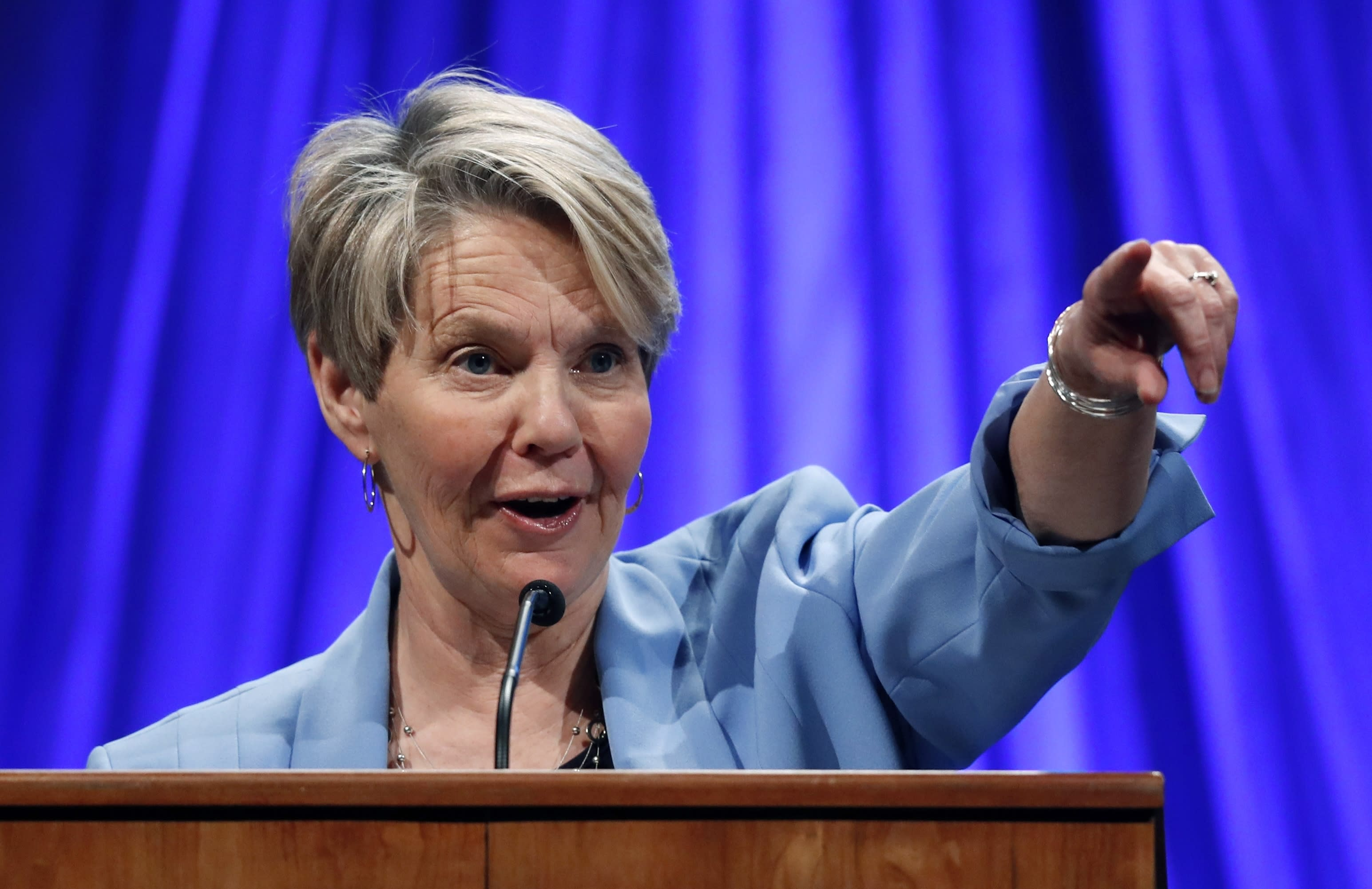 FILE - In this May 19, 2018 file photo, gubernatorial candidate Betsy Sweet speaks at the Democratic convention in Lewiston, Maine. Sweet is one of three Democrat candidates seeking the party's nomination for U.S. Senate in the July 14, 2020, primary. (AP Photo/Robert F. Bukaty, File)