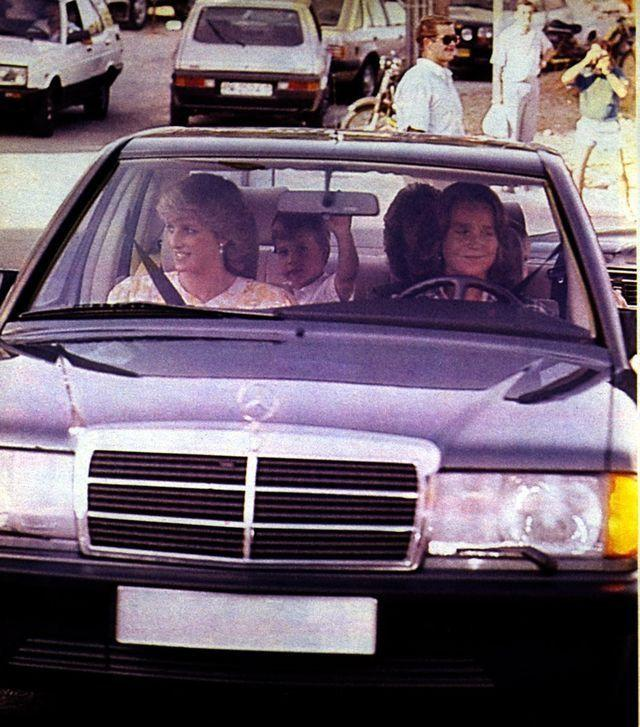 <p>The Princess of Wales rides in the passenger seat of a vintage Mercedes-Benz. </p>