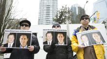 China bristles at Canada over duo detained on spy charges