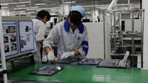 Apple Suppliers Expand Automation in China