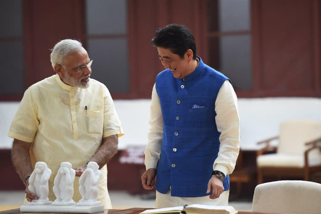 Japanese Prime Minister Shinzo Abe (right) and Indian Prime Minister Narendra Modi visit Sabarmati Ashram in Ahmedabad, on September 13, 2017 (AFP Photo/PRAKASH SINGH)
