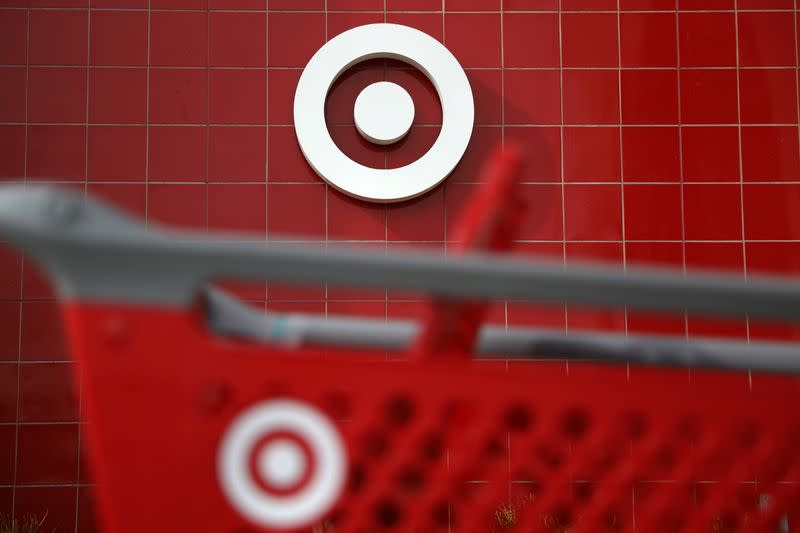 A Target shopping cart is seen in front of a store logo in Azusa