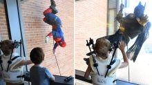 Sick children surprised by police dressed as superheroes