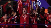 Liverpool lift Premier League trophy after hitting Chelsea for five
