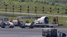 Plane skids off rainy Manila runway, rips off engine, wheel