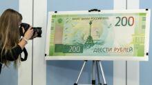 Ukraine bans Russian banknote with Crimea image