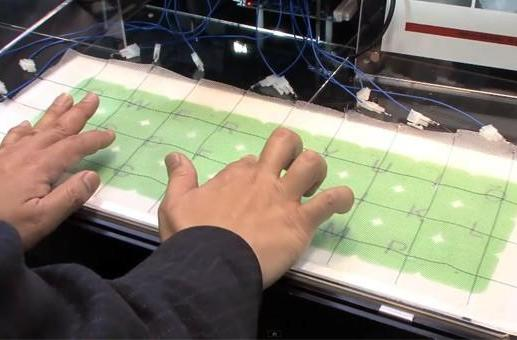 Japanese researchers weave capacitive touch into large-area textiles, want to make them wearable (video)