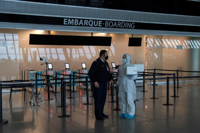 Health workers have been carrying out tests in airports, like here in Uruguay (AFP Photo/Pablo PORCIUNCULA)