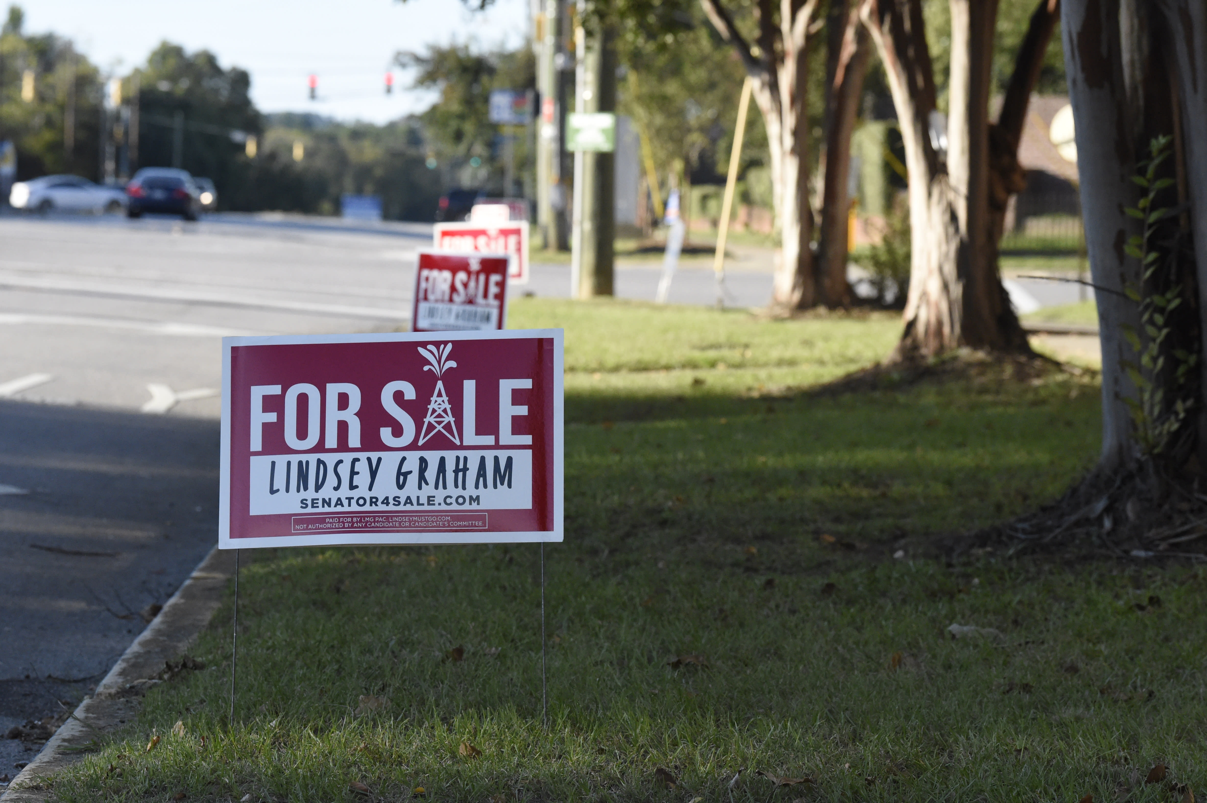 A sign paid for by a political action committee supporting Jaime Harrison, the Democrat challenging U.S. Sen. Lindsey Graham, is placed outside the venue where the two candidates were to meet for their first debate at Allen University, Saturday, Oct. 3, 2020, in Columbia, S.C. (AP Photo/Meg Kinnard)