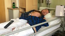 Heartbreaking photo of father dying of cancer cradling his young son
