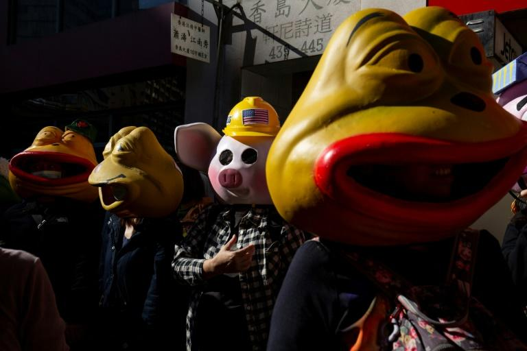 More than 100 people wore giant animal masks on Sunday