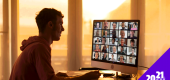 A person logs on to a Zoom meeting. (Getty Images)