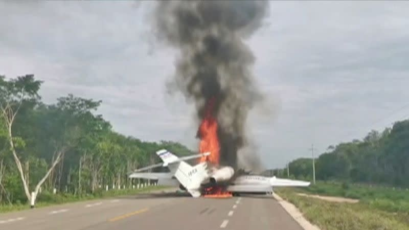 Video grab of a plane suspected of carrying drugs that was reportedly set alight after allegedly being intercepted by soldiers on Federal Highway 184 in Quintana Roo state, Mexico