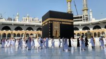 Umrah pilgrims return to a Mecca stilled by COVID-19 slump