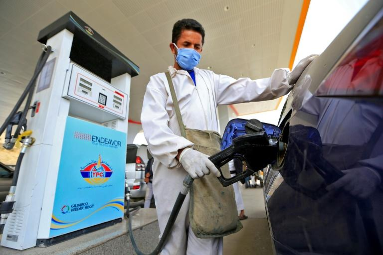 One litre of petrol now sells for 1,200 Yemeni riyals (two dollars) on the black market -- triple the price before the current shortages (AFP Photo/Mohammed HUWAIS)