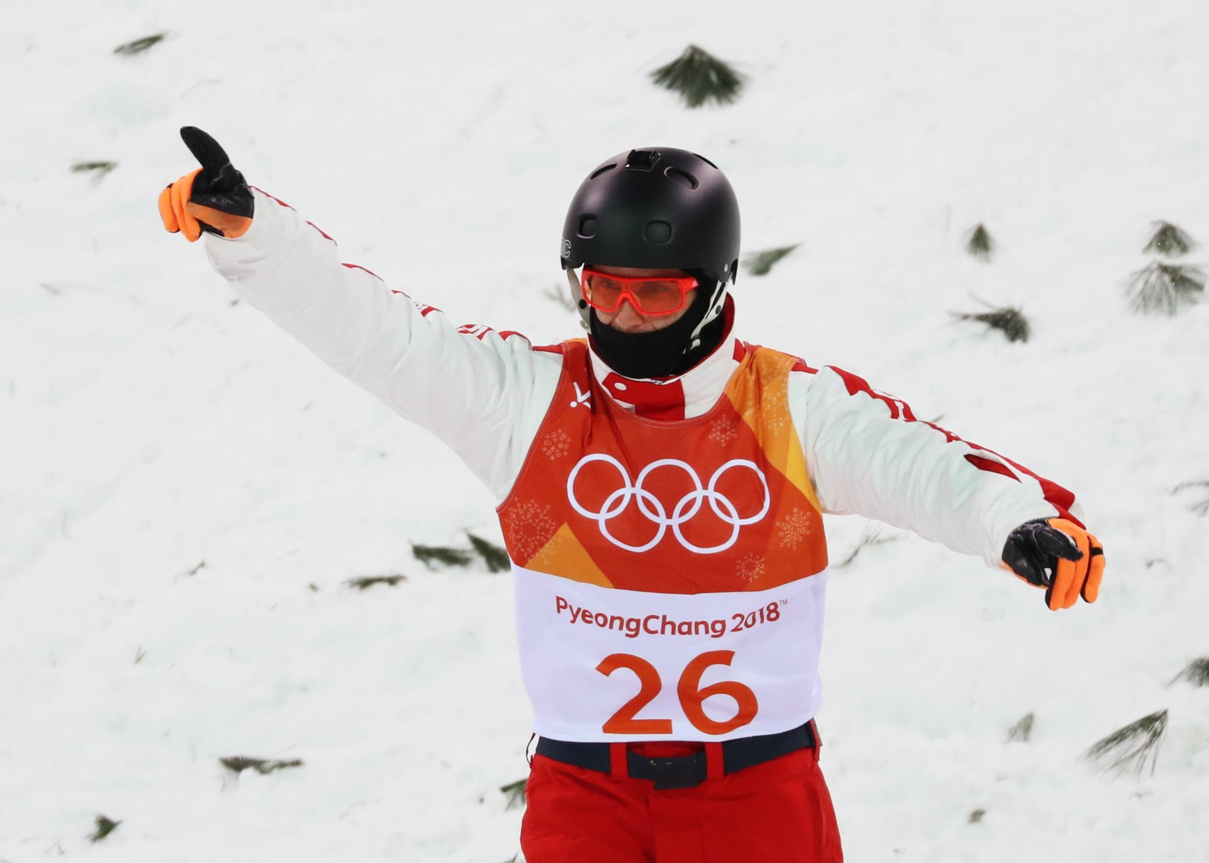 Swiss skier's father biked 10,000 miles to watch his son in Olympics