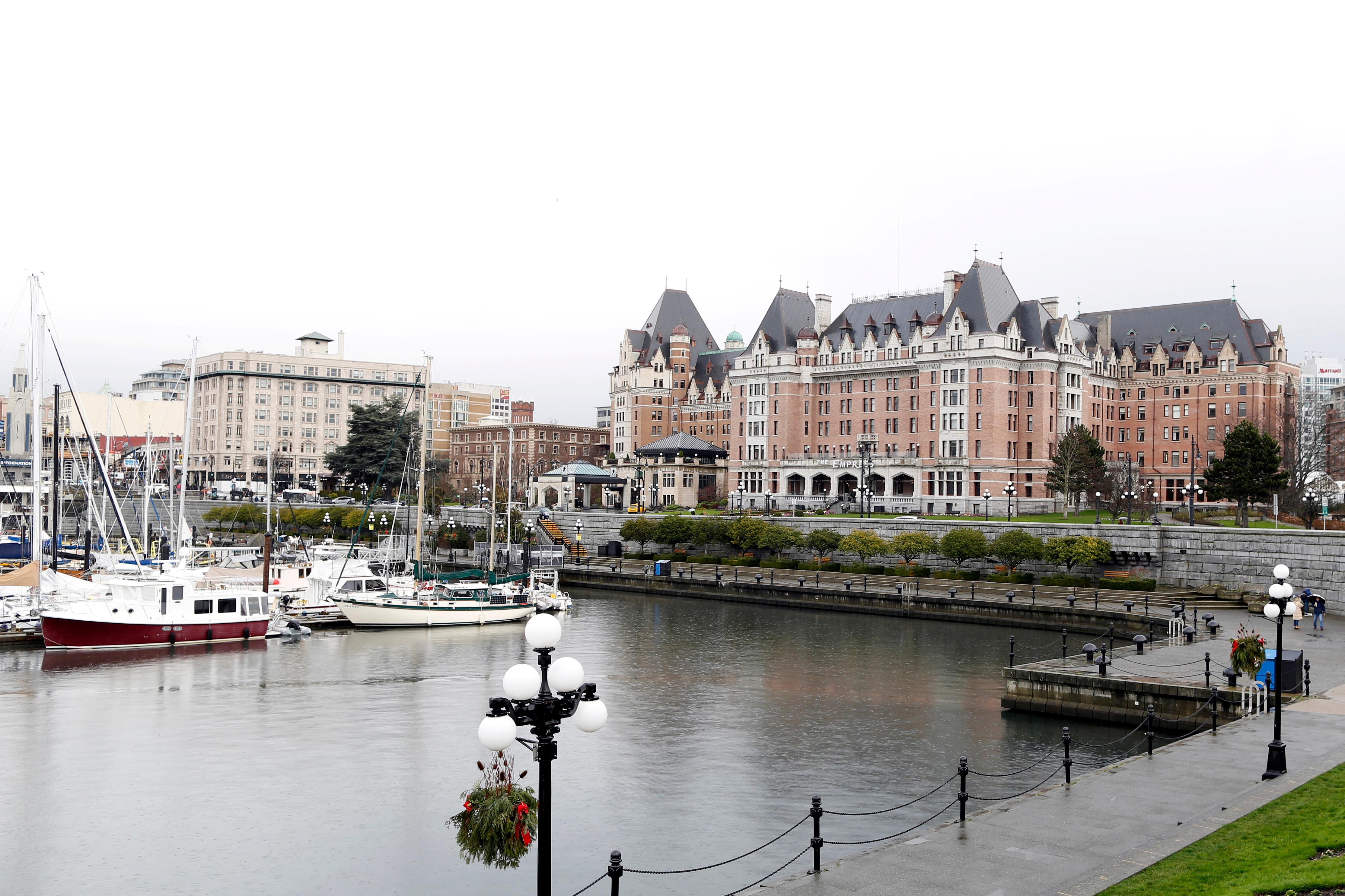 The Fairmont Empress Hotel is seen on the shore of the city's Inner Harbour in Victoria