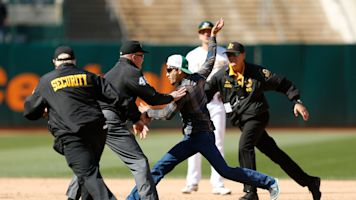 Umpire tackles fan during wild game in Oakland