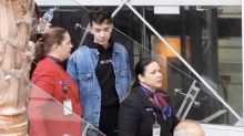 Embattled YouTuber James Charles escorted through Australian airport
