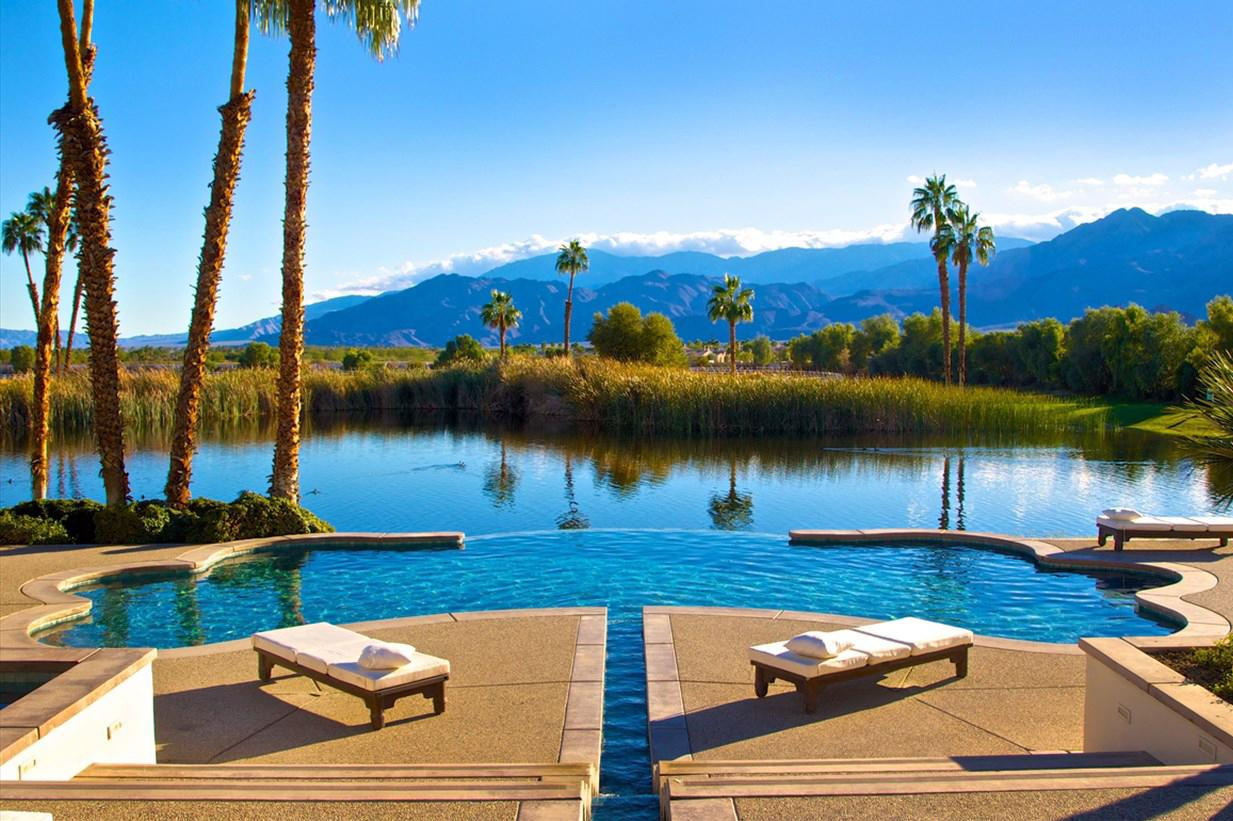 <p><strong>Where?</strong> La Quinta, California, USA</p>  <p>This 39-acre, 13 bedroom equestrian compound can sleep up to 20 people and is set against the Santa Rosa Mountains. You'll have access to an infinity pool and private pond for paddle boating.</p>  <p><strong>Price per person, per week: </strong>£1,375</p>