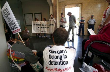 Police watch protesters occupy Australian PM Turnbull's electoral office demanding end to policy of offshore detention in Sydney suburb of Edgecliff, Australia