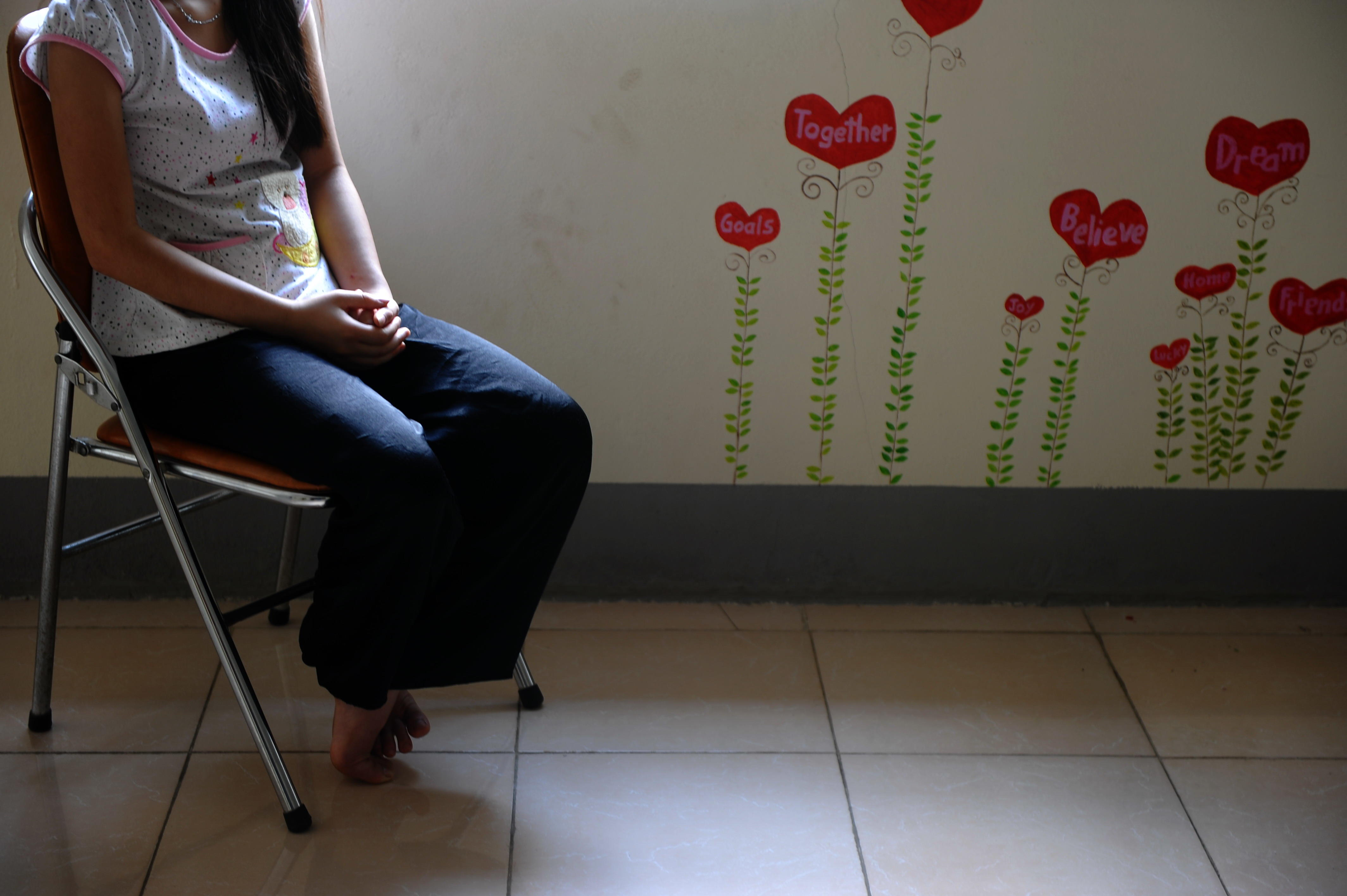 H'mong ethnic teenager May Na (whose name has been changed to protect her identity) sits in the living room at a government-run centre for trafficked women in the northern Vietnamese city of Lao Cai, May 9, 2014 (AFP Photo/Hoang Dinh Nam)