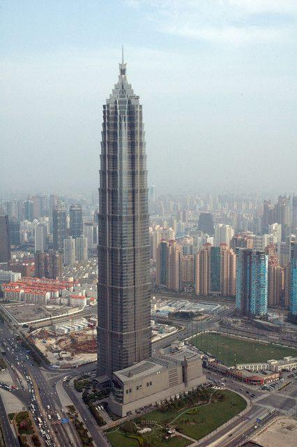 "<p>Certified at the LEED Gold level in 2013, the Jin Mao Tower is 1,380 feet tall with 61 elevators. Completed in 1999, the Tower is the 24th tallest building in the world and the 12th tallest building in China. </p><p>It's a building that shows going green can integrate historic styles with its traditional Chinese architectural style. As reported in <a href=""https://www.worldarchitecturenews.com/article/1517116/towering-achievement"" rel=""nofollow noopener"" target=""_blank"" data-ylk=""slk:World Architecture News"" class=""link rapid-noclick-resp"">World Architecture News</a>, top conservation strategies for the Tower have included ""reusing or recycling 70% of all durable goods and the diversion of 70% of the waste accumulated from facility alterations and additions.""</p>"