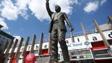 Which football clubs have statues of people who did not play for them?