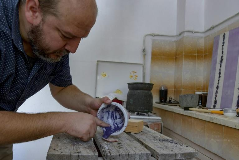 No historical documents clearly detail the production methods for the purple pigment, Drine said (AFP Photo/FETHI BELAID)