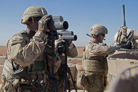 FILE PHOTO: U.S. Soldiers surveil the area during a combined joint patrol in Manbij, Syria, November 1, 2018. Picture taken November 1, 2018. Courtesy Zoe Garbarino/U.S. Army/Handout via REUTERS /File Photo