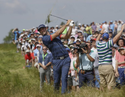 Dustin Johnson hits from the tall grass on No. 17. (AP)