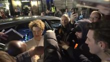 Annette Bening and Gerard Butler mobbed at pre-Bafta dinner in London