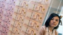 Most Asian units firm; Thai baht hits over 6-year high