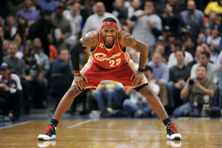 Cleveland Cavaliers forward LeBron James grins after he scored a basket against the New York Knicks in New York