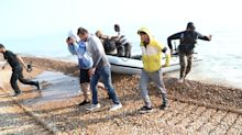 Migrants make off at speed as dinghy lands at Kent beach
