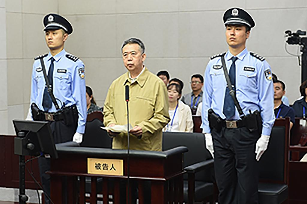Former Interpol chief Meng Hongwei stands in court during his corruption trial in Tianjin, northern China