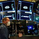 Dow closes lower as earnings roll in