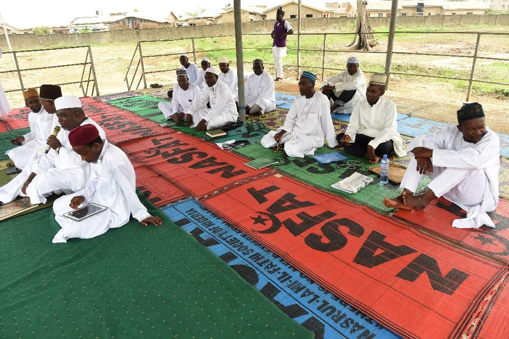 Nigerian Muslims sit at Sunday prayer in Aseese, Ogun State (AFP Photo/PIUS UTOMI EKPEI)