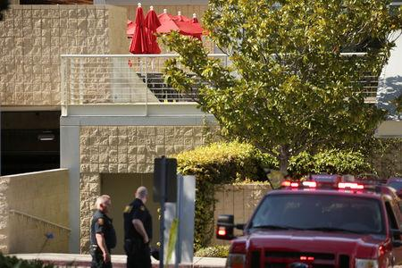 Law enforcement officers are seen near a patio with crime scene markers at Youtube headquarters following an active shooter situation in San Bruno, California