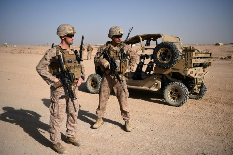 US troops remain in Afghanistan nearly 20 years after invading to rout Al-Qaeda and topple the Taliban