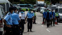 Hong Kong police raid pro-democracy newspaper, arrest owner