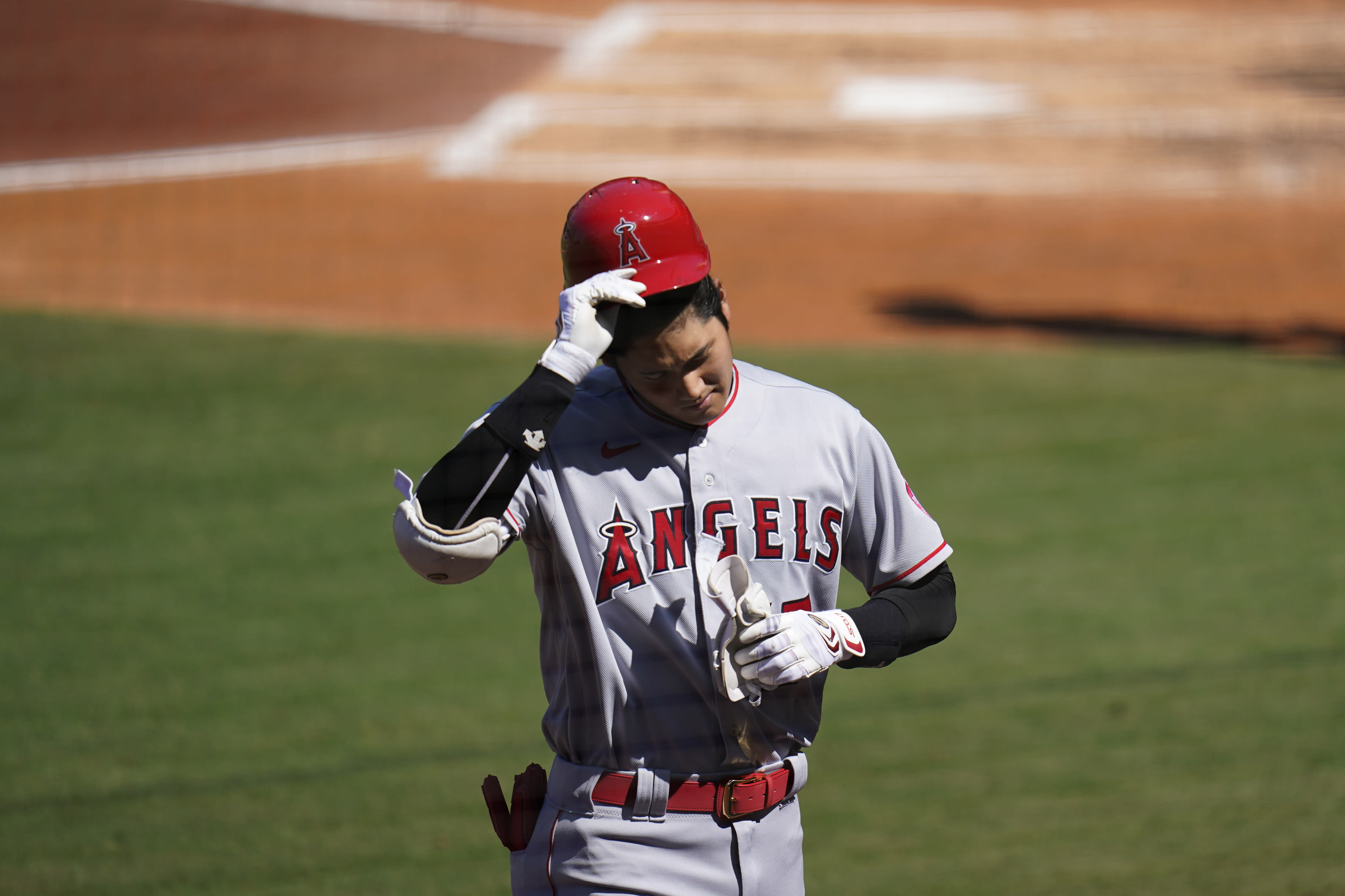 Los Angeles Angels' Shohei Ohtani walks back to the dugout after batting during the third inning of a baseball game against the San Diego Padres, Wednesday, Sept. 23, 2020, in San Diego. (AP Photo/Gregory Bull)