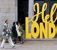 Reopening hopes spur FTSE 250 to new record