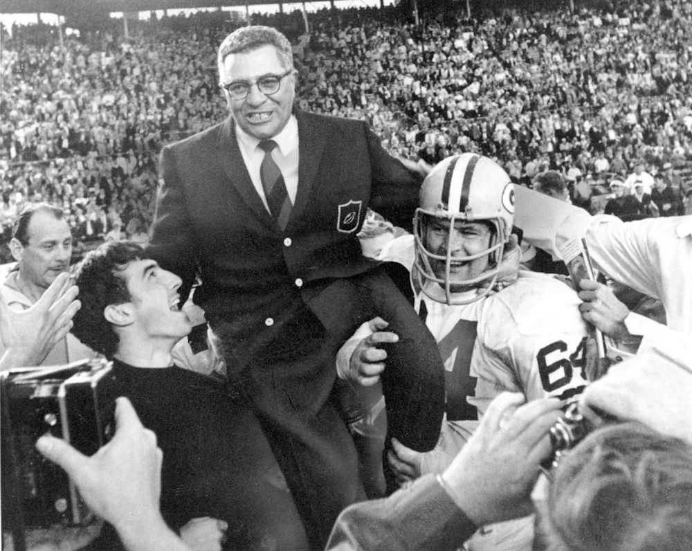 Jerry Kramer (64) in an iconic photo as he helps carry Vince Lombardi off the field after Super Bowl II (AP)