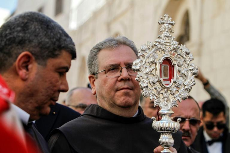 The artefact, held by the chief custodian for the Holy Land Francesco Patton, was returned to Bethlehem as a gift from the Vatican (AFP Photo/Musa AL SHAER)