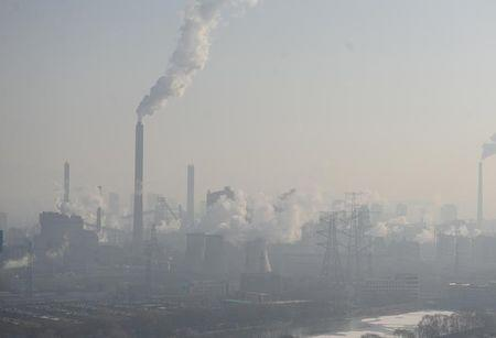Smog billows from chimneys and cooling towers of a steel plant during a hazy day in Taiyuan, Shanxi province, China