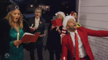John Legend and Chrissy Teigen surprise people by caroling at their homes